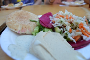 Pita, hummus, tzatziki sauce, beets and cabbage salad